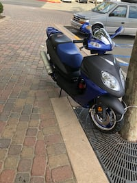 Blue and black motor scooter 2401 mi