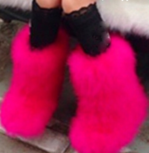 Women's pair of pink fur boots