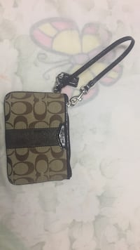 brown and gray monogrammed Coach wristlet