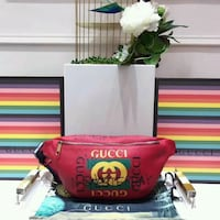 women's red Gucci leather bag