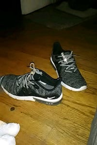 pair of black-and-white Nike running shoes St. Louis