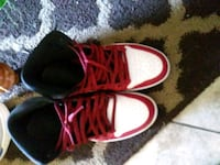 pair of red-and-white Nike basketball shoes 691 mi
