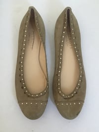 pair of brown leather flats 793 km