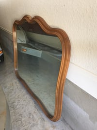 brown wooden-framed mirror