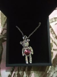 silver-colored necklace with pink gemstone pendant Hyattsville