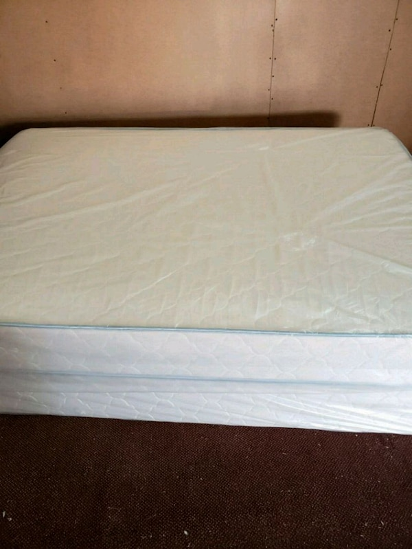 white mattress with white bed frame