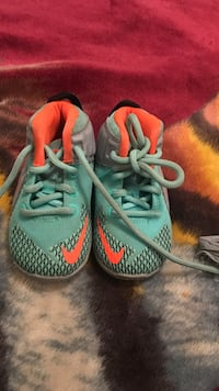 pair of green-and-orange Nike running shoes San Antonio, 78227