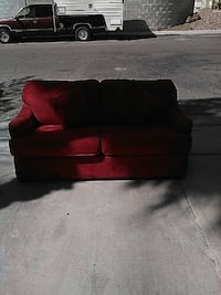 red padded 2-seat sofa