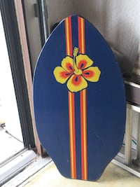 blue and red wooden surfboard 774 mi
