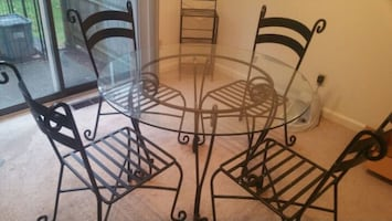 Rod Iron Table with Four Matching Rod Iron Chairs