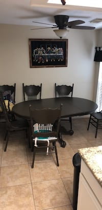 round brown wooden table with four chairs dining set League City, 77573