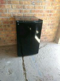 black and gray compact refrigerator