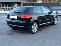 black Audi 3-door hatchback QUEBEC