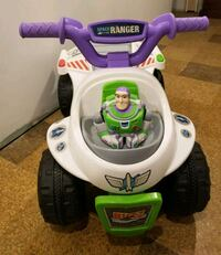 white and purple ride-on ATV toy