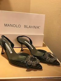 Manolo Sling backs. Size 6. Original dust cloth and box included. Never worn