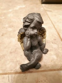 Black thougthful Angel with gold wings