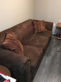 Nice couch good condition with throw pillows