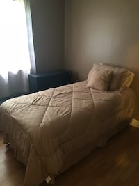 beige bed sheet and pillow Apopka