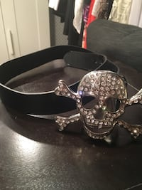 black leather belt with silver-colored clear gemstone encrusted skull and bone buckle Laval, H7R 4V2
