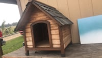 brown and black wooden doghouse 2363 mi