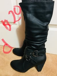 Pair of black leather knee-high boots St Catharines, L2T 1B4