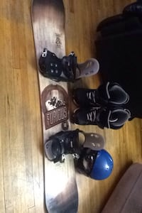 brown and black snowboard with bindings