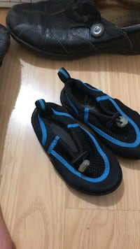 Like new size Medium Speedo sandals/ water shoes. Probably fits a 2/3 year old. Laval, H7T 1C8
