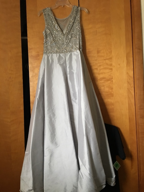 Used Evening gown. Has some water stains on body of the dress for ...