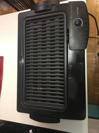 black and white T-Fal space heater