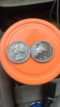 1989 quarter. one with mint mark p.  the other  is missing the word in Phoenix, 85051