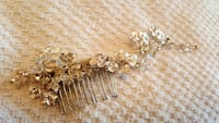 gold-colored and diamond studded accessory Vaughan