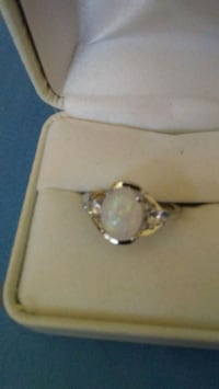 GOURGOUS FIRE WHITE OPAL.  AND TOPAZ ON SIDE RING