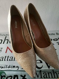 pair of gray glitter heeled shoes with text overlay Montréal, H1G 5N6