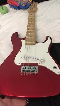 red and white stratocaster electric guitar Kill Devil Hills, 27948