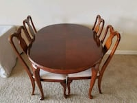 round brown wooden table with four chairs dining s Bee Cave, 78738