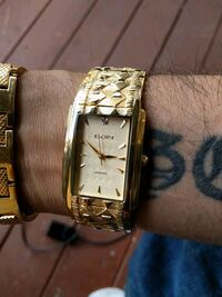 square gold analog watch with gold link bracelet Chestermere, T1X 1W2