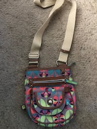 Purse with attached wallet