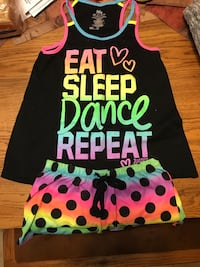 black, yellow, pink, and teal racer back tank top with polka dotted shorts