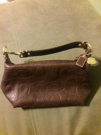 Beautiful clutch size Coach purse