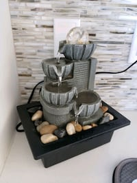 Fountain with river rocks
