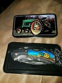 Knife in tractor tin case