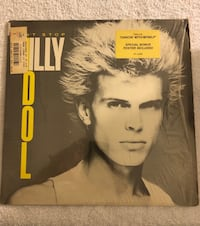 This Billy Idol album is in very good condition . The poster awesome. Pompano Beach