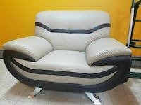 white and black leather sofa chair
