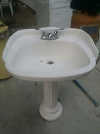 white ceramic pedestal sink with stainless steel faucet Pacoima, 91331