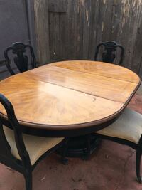 round brown wooden pedestal table Stockton, 95207