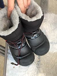 pair of black sheepskin boots 2250 mi