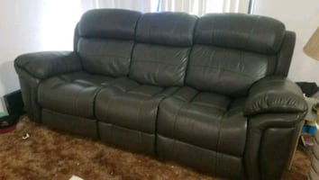 Grey leather recliner comes with cloth cover