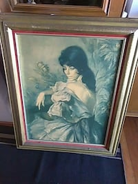 woman painting with brown frame