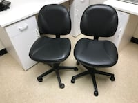 two black leather rolling chairs Burke