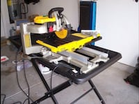 Brand new DEWALT 10-in 1.5 Wet/Dry Bridge Sliding Table Tile Saw with Stand Brighton, 80601